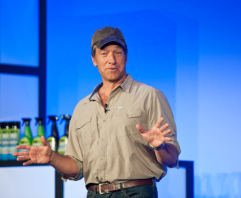 TV star Mike Rowe on stage at corporate event